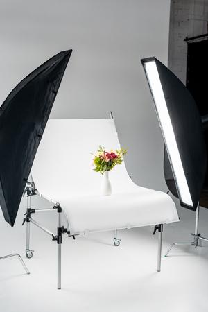 bouquet of flowers arranged in vase in professional photo studio Stockfoto