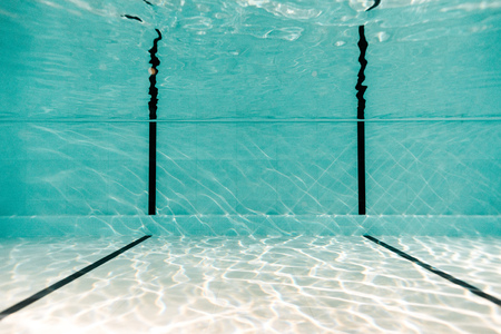 underwater in empty swimming pool with blue water Reklamní fotografie - 118639179