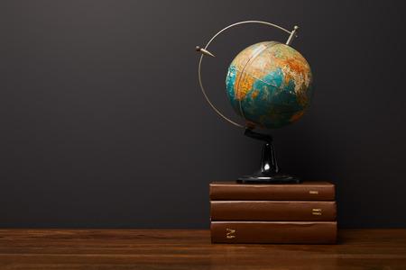 globe near books on wooden textured table 스톡 콘텐츠