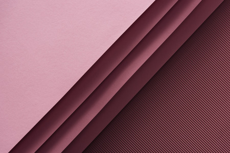 top view of pink and empty sheets of paper on burgundy background