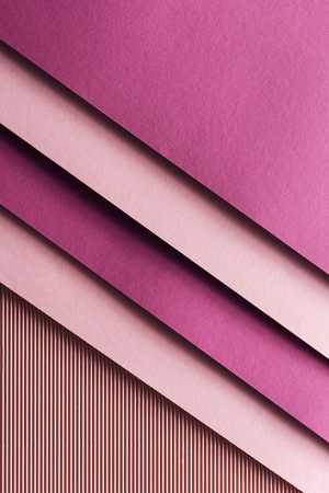 top view of pink and burgundy sheets of paper on pink background with copy space 写真素材
