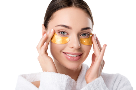 beautiful smiling woman with golden eye patches looking at camera isolated on white