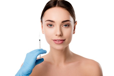 doctor in latex glove holding syringe for giving beauty injection to smiling woman isolated on white