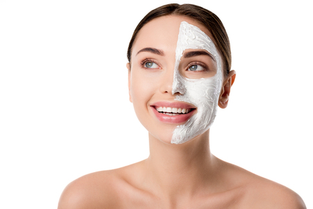 beautiful woman with facial skin care mask isolated on white with copy space Stockfoto