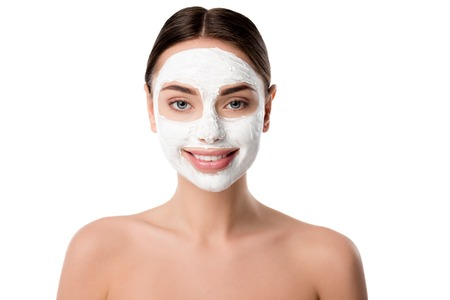 smiling woman with facial skin care mask isolated on white