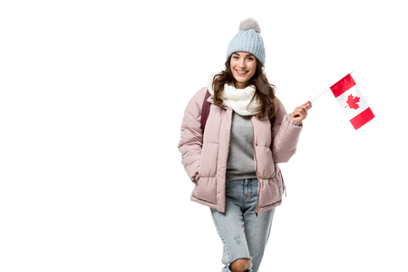 smiling female student in winter clothes holding canadian flag and looking at camera isolated on white Stok Fotoğraf - 118408570