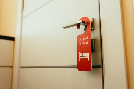 red do not disturb symbol on door handle in hotel