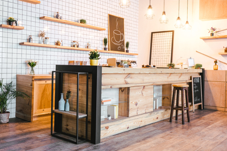 wooden brown bar counter with plant in coffee house Reklamní fotografie