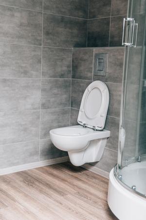 interior of modern bathroom with white ceramic toilet