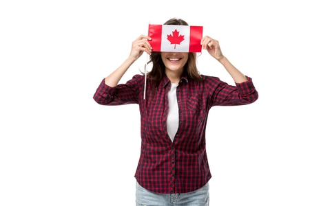woman holding canadian flag in front of face isolated on white