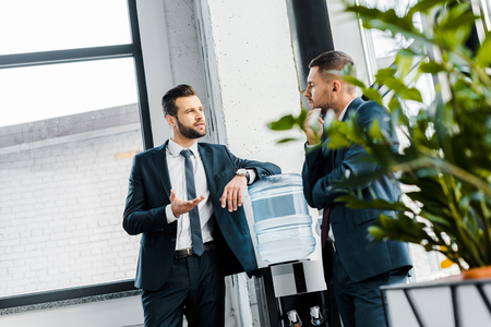 businessman having discussion with coworker in modern office Reklamní fotografie