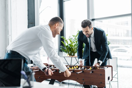 happy businessmen playing table football in modern office Stok Fotoğraf
