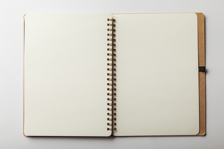 top view of opened notebook with blank pages on white background