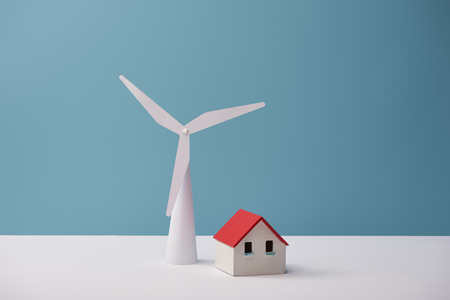 windmill and house models on white table and blue background Stock fotó