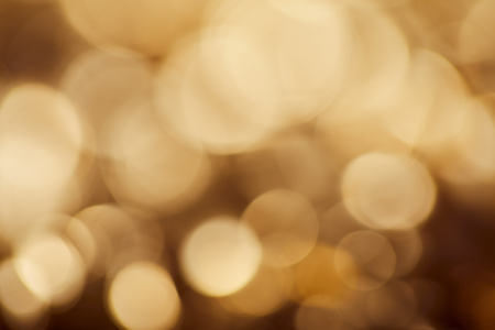 bright brown background with golden sparkling lights Stock Photo