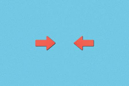 top view of horizontal opposite red pointers on blue background Stock Photo