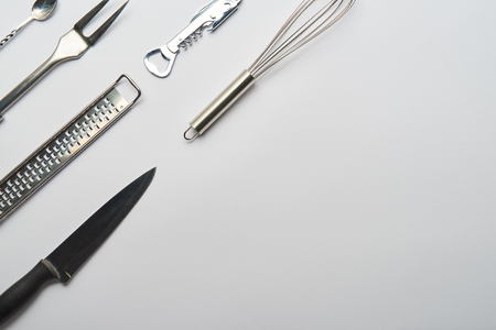 top view of metal cooking utensils on grey background with copy space Reklamní fotografie