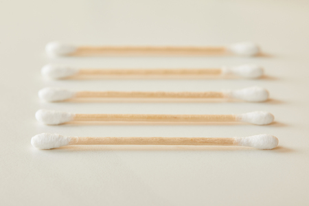 selective focus of ear sticks on white marble background
