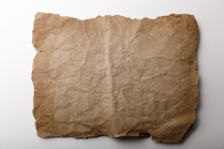 top view of old paper sheet lying on white background Stock Photo - 118535407