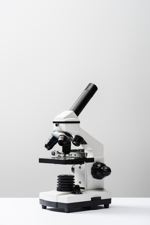 microscope on grey background with copy space Reklamní fotografie