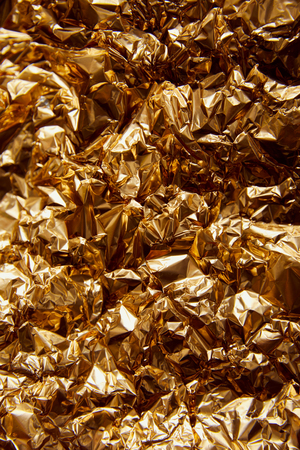 crumpled golden foil with glares and sparkles