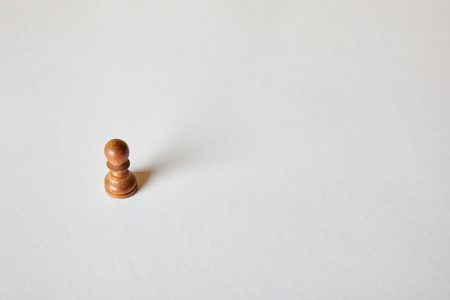 wooden pawn piece of chess on grey background
