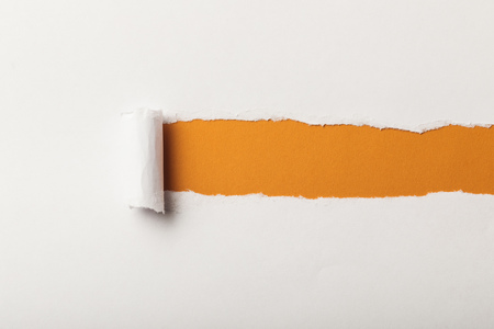 torn paper with rolled edge and copy space on orange background Banco de Imagens