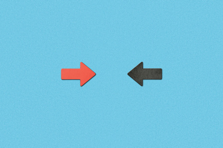 top view of opposite horizontal red and black arrows on blue background Stock Photo
