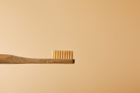 bamboo brown toothbrush on beige background 스톡 콘텐츠