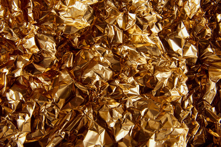 top view of crumpled golden foil with glares Stock fotó - 118589977