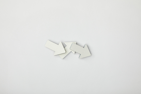 top view of grey and white pointers on grey background