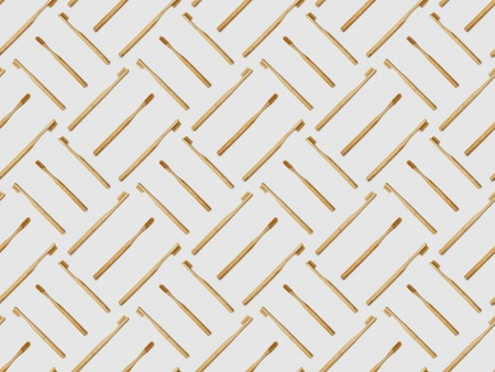 bamboo toothbrushes in different directions on grey background, seamless background pattern Stock Photo
