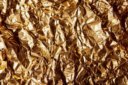 creased golden foil sheet with twinkles Reklamní fotografie