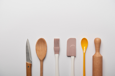 top view of cooking utensils on grey background with copy space