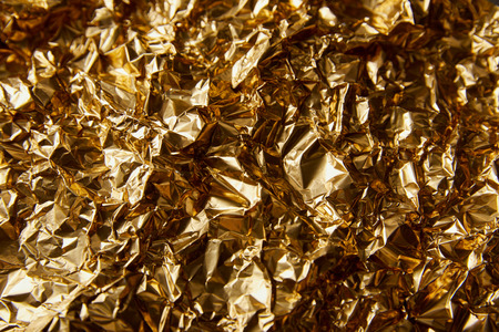 top view of crumpled golden foil with twinkles 写真素材