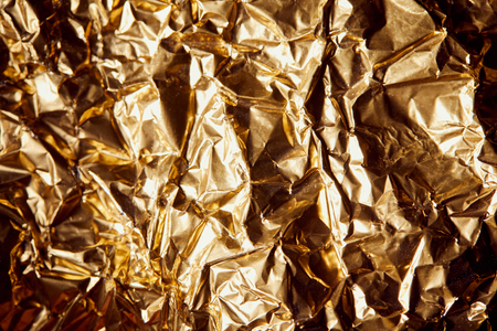 crumpled golden foil with shadows and twinkles Reklamní fotografie