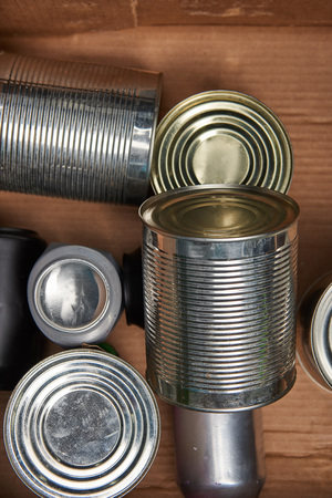 different iron silver cans in cardboard box