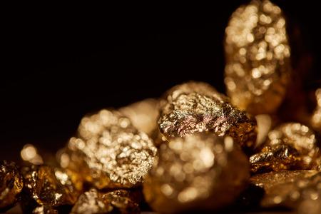 golden blurred stones isolated on black Archivio Fotografico