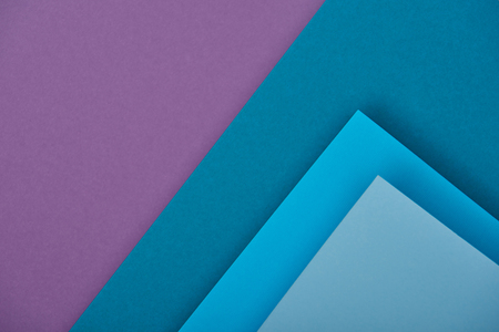 top view of purple and blue paper sheets with copy space