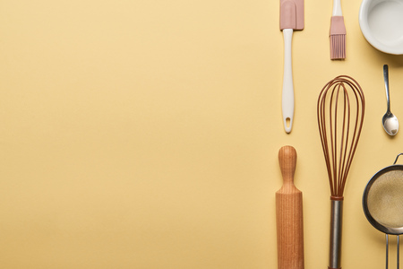 flat lay with cooking utensils on yellow background with copy space