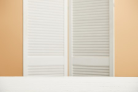 selective focus of wooden room divider and white surface Stock Photo