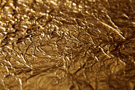 selective focus of sheet golden foil with glares