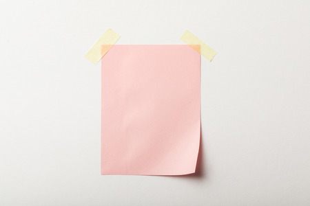 pink blank paper with sticky tape on white background Stockfoto