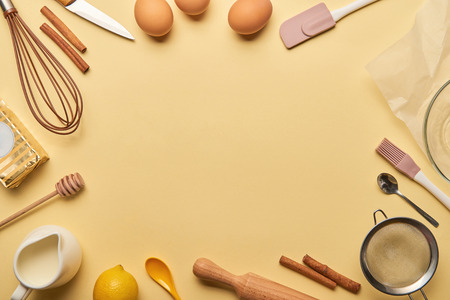 top view cooking utensils and ingredients frame on yellow background with copy space Stok Fotoğraf