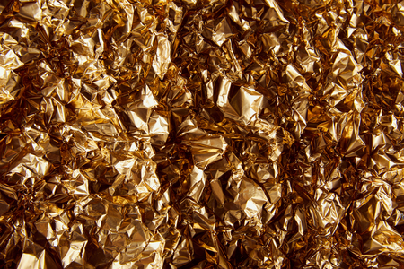 top view of crumpled golden foil with twinkles 스톡 콘텐츠