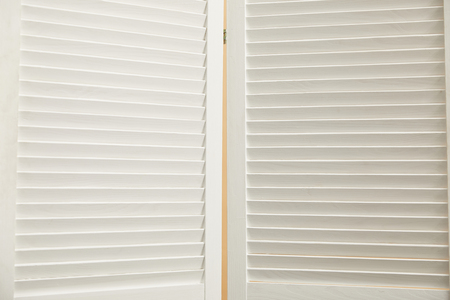 close up of  white wooden room divider with copy space Stock Photo