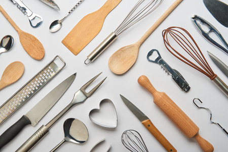 top view of metal and wooden cooking utensils on grey background 스톡 콘텐츠