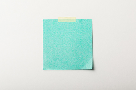 turquoise blank sticker with sticky tape on white background