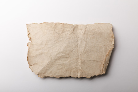 top view of aged paper sheet lying on white background Stock Photo - 118536436