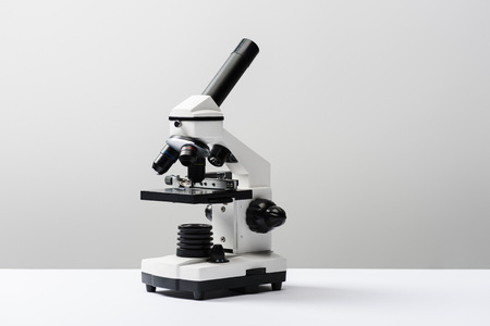 microscope on grey background with copy space